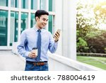 happy young businessman using a ... | Shutterstock . vector #788004619