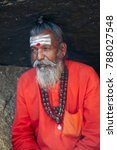 Small photo of Varanasi, India- March 17, 2014: Indian Brahman on the banks of the Ganges River, editorial.
