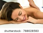 young woman receiving a back... | Shutterstock . vector #788028583