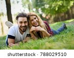 beautiful young couple laying... | Shutterstock . vector #788029510