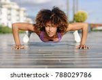 black fit woman doing pushups... | Shutterstock . vector #788029786