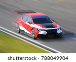 Small photo of Race car racing at high speed on speed track with motion blur at sunny day on a racing track
