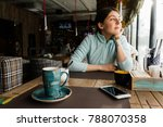 a young girl is sitting in a... | Shutterstock . vector #788070358