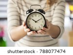 showing black alarm clock | Shutterstock . vector #788077474
