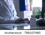 Small photo of Fake doctor, quack or charlatan in hospital office. Medical crime, illegal health care, insurance fraud, negligence, treatment error or malpractice. Man in dark hospital typing computer prescription.