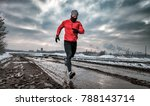 athlete running in dirty puddle ... | Shutterstock . vector #788143714