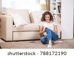 beautiful young woman at home... | Shutterstock . vector #788172190