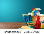 Small photo of Image with various tools for cleaning the premises and cleaning agents on a blue background. The concept of cleaning the premises, cleanliness.