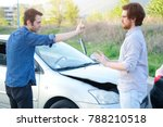 Small photo of Two angry men arguing after a car fender-bender crash