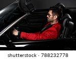 handsome brutal man in the car | Shutterstock . vector #788232778