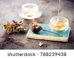 old book  herbal tea and dried... | Shutterstock . vector #788239438