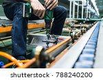 maintenance repair conveyor line | Shutterstock . vector #788240200