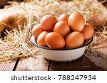 bowl of fresh eggs on wooden... | Shutterstock . vector #788247934