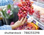 woman choosing bunch fresh red... | Shutterstock . vector #788253298