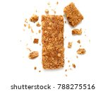 Stock photo cereal bars or flapjacks made from rolled oats with crumbs isolated on white background top view 788275516