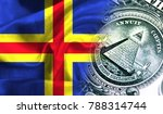 Small photo of Flag of Aland on a fabric with an American dollar close-up.