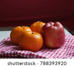 apples and mandarins on warm... | Shutterstock . vector #788393920