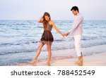 young couple walking at sunset ... | Shutterstock . vector #788452549
