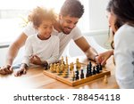 happy family playing chess... | Shutterstock . vector #788454118