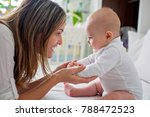 young mother lying in bed with... | Shutterstock . vector #788472523