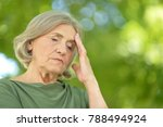 thoughtful senior woman in park | Shutterstock . vector #788494924