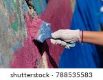 The Street Painter Paints The...