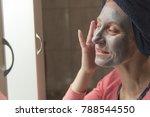 mature woman applying a face... | Shutterstock . vector #788544550