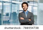 handsome manager smiling   Shutterstock . vector #788554738
