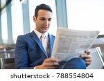 man reading a newspaper | Shutterstock . vector #788554804