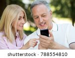 smiling man showing his mobile... | Shutterstock . vector #788554810