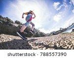 sporty runner woman run on the... | Shutterstock . vector #788557390