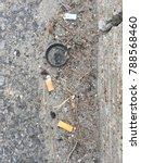 cigarette butts on asphalt | Shutterstock . vector #788568460