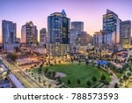 Charlotte, North Carolina, USA uptown skyline and park.