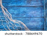 Old Blue Board With Fishing Ne...