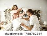 Stock photo couple having a fun while pillow fight 788782969