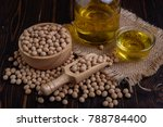 soy bean with soy oil on wooden ...   Shutterstock . vector #788784400