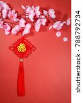 Small photo of Chinese New Year decorations on red background (English translation for foreign text means blessing)
