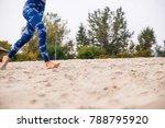 Woman Running On The Beach ...