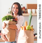 young woman holding grocery...   Shutterstock . vector #788802448