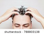 young manis washing his hair ... | Shutterstock . vector #788803138