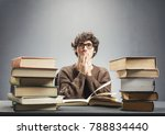 young man studying the books ... | Shutterstock . vector #788834440