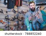 young positive man choosing... | Shutterstock . vector #788852260
