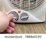 man adjusts the temperature of...   Shutterstock . vector #788860150