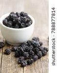Small photo of The dried chokeberries. Black aronia berries.