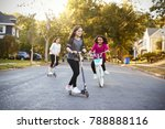 three girls riding down the... | Shutterstock . vector #788888116