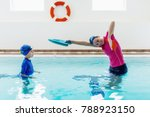 boy having a swimming lesson... | Shutterstock . vector #788923150