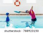 boy having a swimming lesson... | Shutterstock . vector #788923150