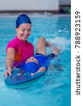 boy having a swimming lesson... | Shutterstock . vector #788923159