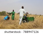 farmers cutting grass in a... | Shutterstock . vector #788947126