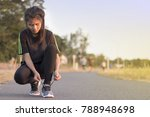 asia woman tying shoe laces.... | Shutterstock . vector #788948698